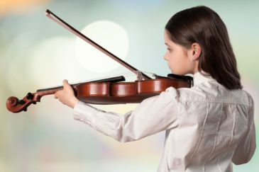 earning to play an instrument can help kids grow socially and academically.