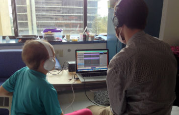 Oliver Jacobson helps a young patient make music at the Benioff Children's Hospital.