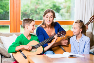 Keep music therapy programs going at home by getting the entire family involved.